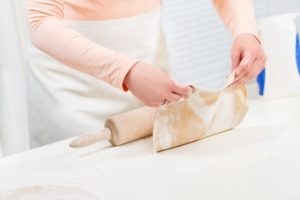 girl-baking-and-roll-dough